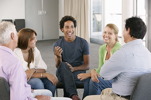 group of individuals participating in a psychotherapy program